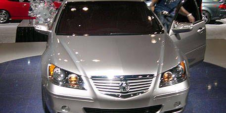 Motor vehicle, Mode of transport, Vehicle, Transport, Automotive mirror, Glass, Automotive design, Land vehicle, Event, Automotive lighting,