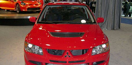 Automotive design, Vehicle, Automotive mirror, Hood, Car, Grille, Red, Automotive lighting, Automotive exterior, Bumper,