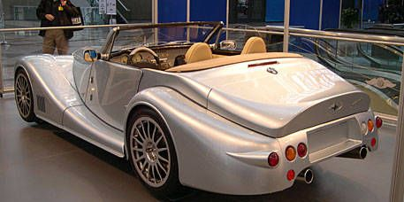 Mode of transport, Automotive design, Vehicle, Photograph, Car, Fender, Convertible, Roadster, Alloy wheel, Personal luxury car,