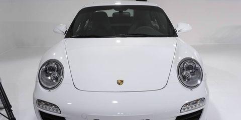 Automotive design, Vehicle, Land vehicle, Car, Automotive lighting, White, Fender, Bumper, Sports car, Glass,