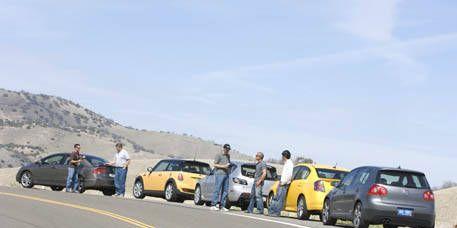 Motor vehicle, Mode of transport, Vehicle, Yellow, Land vehicle, Transport, Car, Road, Automotive parking light, Asphalt,