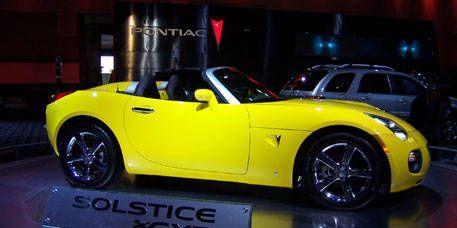 Tire, Motor vehicle, Wheel, Mode of transport, Automotive design, Yellow, Vehicle, Land vehicle, Automotive wheel system, Car,