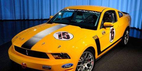Motor vehicle, Tire, Automotive design, Vehicle, Yellow, Headlamp, Hood, Car, Performance car, Rim,