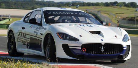 Vehicle, Automotive design, Car, Performance car, Hood, Rallying, Sports car, Rim, Maserati, Plain,