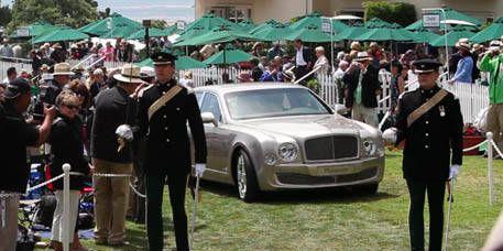 People, Vehicle, Transport, Land vehicle, Car, Grille, Community, Umbrella, Crowd, Luxury vehicle,