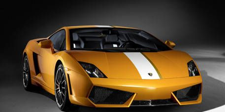 Mode of transport, Automotive design, Transport, Automotive exterior, Yellow, Vehicle, Land vehicle, Rim, Automotive lighting, Car,