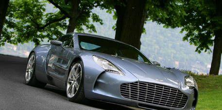 Mode of transport, Automotive design, Vehicle, Headlamp, Rim, Automotive mirror, Automotive lighting, Car, Performance car, Fender,