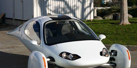 Motor vehicle, Mode of transport, Automotive design, Automotive mirror, Vehicle, Headlamp, Hood, White, Car, Automotive side-view mirror,