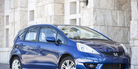 Tire, Wheel, Motor vehicle, Automotive mirror, Mode of transport, Automotive design, Blue, Automotive tire, Vehicle, Glass,