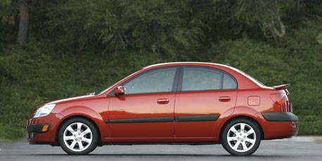 Tire, Wheel, Automotive design, Vehicle, Transport, Car, Red, Vehicle door, Rim, Automotive mirror,