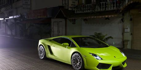 Tire, Motor vehicle, Wheel, Mode of transport, Automotive design, Vehicle, Transport, Automotive exterior, Yellow, Rim,