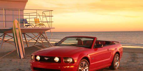 Tire, Automotive design, Vehicle, Hood, Automotive lighting, Landscape, Red, Car, Rim, Headlamp,