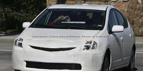 Automotive design, Vehicle, Land vehicle, Car, White, Headlamp, Alloy wheel, Automotive mirror, Automotive tire, Grille,