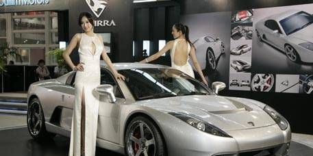 Tire, Motor vehicle, Wheel, Mode of transport, Automotive design, Vehicle, Land vehicle, Event, Rim, Car,