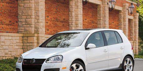 Tire, Wheel, Motor vehicle, Automotive mirror, Automotive design, Mode of transport, Daytime, Vehicle, Brick, Transport,