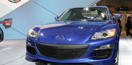 Motor vehicle, Mode of transport, Automotive design, Blue, Vehicle, Transport, Event, Hood, Land vehicle, Headlamp,