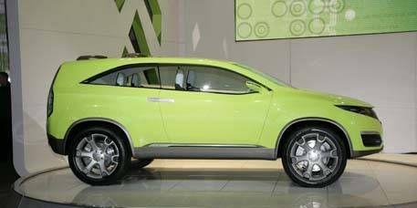Motor vehicle, Tire, Automotive design, Yellow, Vehicle, Automotive tire, Automotive exterior, Car, Automotive wheel system, Rim,