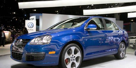 Motor vehicle, Automotive design, Blue, Vehicle, Land vehicle, Transport, Car, Alloy wheel, Automotive mirror, Automotive lighting,