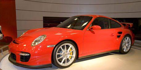 Tire, Wheel, Automotive design, Vehicle, Land vehicle, Car, Rim, Alloy wheel, Red, Spoke,