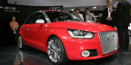 Tire, Wheel, Automotive design, Product, Vehicle, Event, Land vehicle, Car, Red, Alloy wheel,