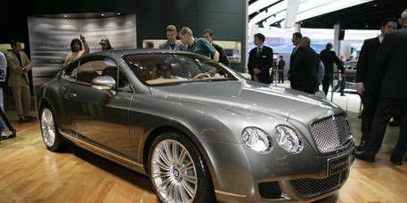 Tire, Automotive design, Vehicle, Bentley, Rim, Car, Personal luxury car, Grille, Floor, Alloy wheel,