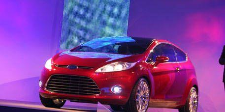 Tire, Motor vehicle, Wheel, Mode of transport, Automotive design, Product, Automotive mirror, Automotive tire, Transport, Car,