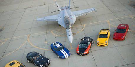 Motor vehicle, Airplane, Mode of transport, Vehicle, Automotive design, Land vehicle, Transport, Automotive parking light, Automotive exterior, Car,