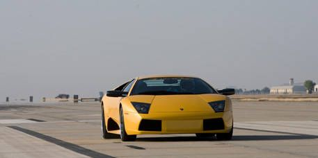 Motor vehicle, Tire, Mode of transport, Automotive design, Road, Automotive exterior, Transport, Yellow, Vehicle, Automotive lighting,