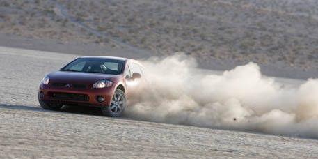 Tire, Automotive design, Vehicle, Land vehicle, Car, Automotive exterior, Landscape, Hood, Motorsport, Automotive lighting,