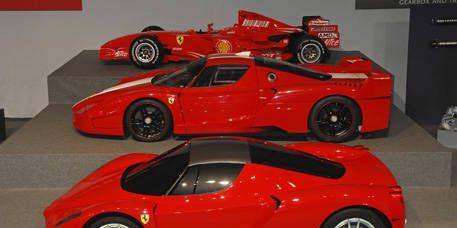 Tire, Wheel, Mode of transport, Automotive design, Vehicle, Land vehicle, Alloy wheel, Car, Red, Performance car,