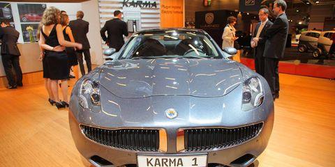 Motor vehicle, Automotive design, Vehicle, Land vehicle, Grille, Car, Personal luxury car, Vehicle registration plate, Luxury vehicle, Exhibition,