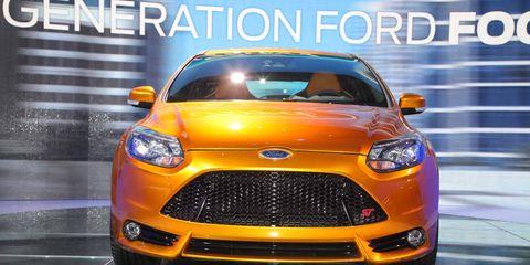 Motor vehicle, Automotive design, Vehicle, Product, Yellow, Automotive lighting, Event, Headlamp, Automotive mirror, Land vehicle,