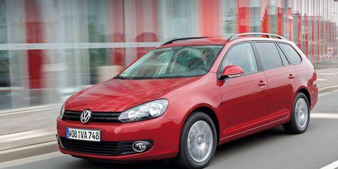 Motor vehicle, Automotive design, Automotive mirror, Daytime, Vehicle, Land vehicle, Car, Glass, Headlamp, Red,