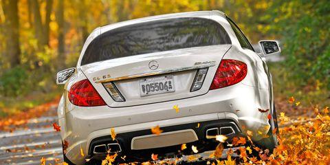 Automotive design, Vehicle, Vehicle registration plate, Automotive lighting, Automotive tail & brake light, Car, Automotive exterior, Deciduous, Amber, Personal luxury car,
