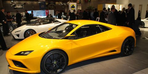 Tire, Wheel, Automotive design, Mode of transport, Vehicle, Land vehicle, Yellow, Event, Performance car, Car,