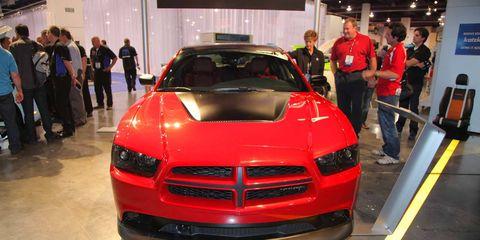 Automotive design, Vehicle, Event, Grille, Car, Hood, Exhibition, Auto show, Bumper, Automotive lighting,