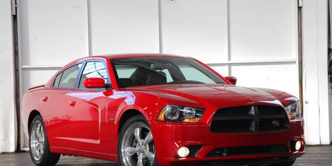 Tire, Wheel, Automotive design, Vehicle, Automotive lighting, Transport, Hood, Headlamp, Car, Red,