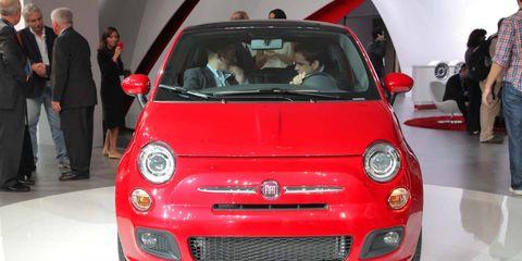 Automotive design, Vehicle, Land vehicle, Red, Car, Bumper, Suit, Hood, Automotive lighting, City car,