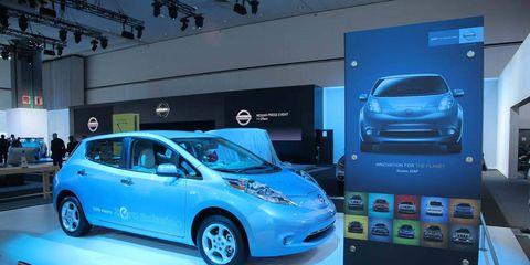 Motor vehicle, Automotive design, Vehicle, Land vehicle, Car, Auto show, Exhibition, Logo, Machine, Automotive mirror,