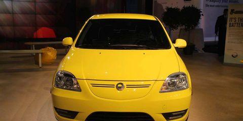 Automotive design, Yellow, Vehicle, Hood, Car, Headlamp, Automotive lighting, Orange, Bumper, Automotive mirror,