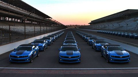 Automotive design, Blue, Vehicle, Hood, Sport venue, Automotive exterior, Grille, Automotive lighting, Automotive parking light, Performance car,