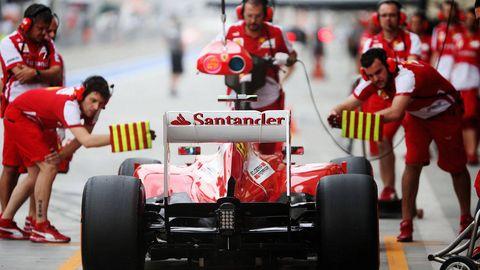 Tire, Wheel, Automotive design, Open-wheel car, Automotive tire, Red, Human leg, Formula one tyres, Race car, Automotive wheel system,