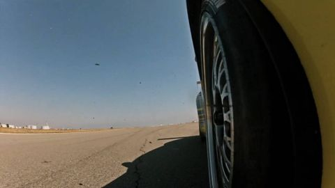 Tire, Automotive tire, Blue, Alloy wheel, Rim, Atmosphere, Automotive wheel system, Automotive exterior, Landscape, Synthetic rubber,