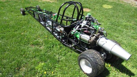Grass, Chassis, Rim, Automotive tire, Auto part, Lawn, Tread, Automotive wheel system, Open-wheel car, Synthetic rubber,