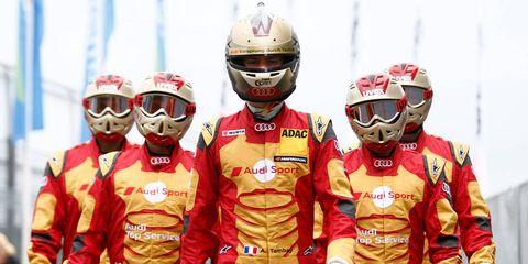 Helmet, Sports uniform, Personal protective equipment, Red, Team, Sports gear, Headgear, Championship, Racing, Curtain,