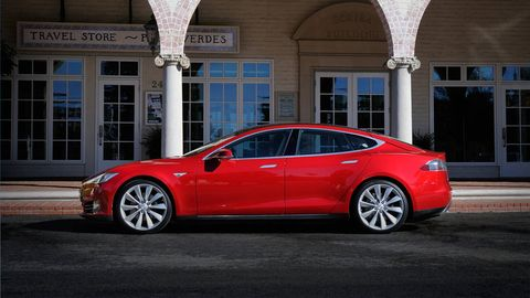 Tire, Wheel, Vehicle, Window, Architecture, Car, Rim, Red, Alloy wheel, Personal luxury car,