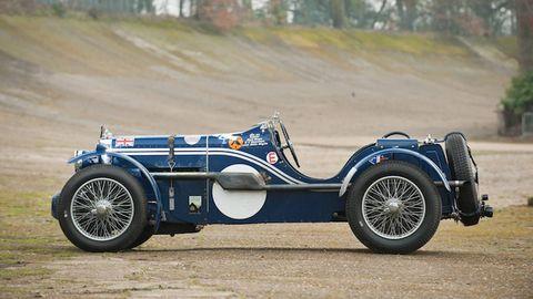 Tire, Automotive design, Blue, Automotive tire, Car, Fender, Rim, Classic, Classic car, Automotive wheel system,