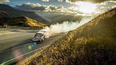 Road, Automotive design, Car, Motorsport, Automotive lighting, Automotive exterior, Terrain, Mountain range, Race car, Auto racing,