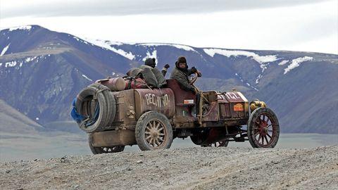 Wheel, Mode of transport, Automotive tire, Mountainous landforms, Automotive design, Mountain range, Highland, Fender, Automotive wheel system, Mountain,