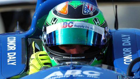 Personal protective equipment, Sports gear, Helmet, Logo, Headgear, Race car, World, Racing, Auto racing, Brand,